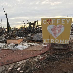 burned out lot with a Coffey Strong sign